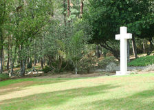 White cross on green grassy hill Stock Photos