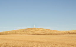 White cross on a hill Royalty Free Stock Photo