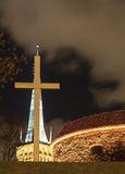 White cross and illuminated church in Tallinn, Estonia Stock Photography