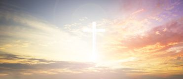 Cross on blurry sunset background, Royalty Free Stock Images