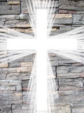 White cross with light rays and stone background christian symbol of resurrection Royalty Free Stock Photos