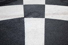 White Cross lines on black asphalt Stock Photography