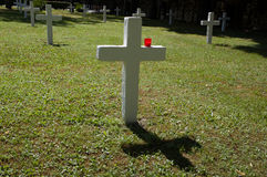 White cross with red candle. In military cemetery, Prague stock photography
