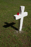 White cross with red candle. In military cemetery, Prague royalty free stock photography