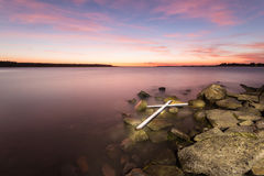 White Cross on Rocks Royalty Free Stock Image