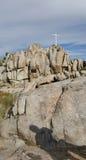 White Cross in Desert Landscape. White Cross on Rocks Honoring the Dead in Wilderness Landscape stock photography
