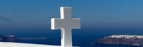 White cross in front of blue sky Stock Photo