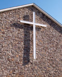 White cross on stone church building royalty free stock photos