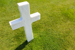White cross for an unknown soldier at american cemetery in Colle. White cross for an unknown soldier at the american cemetery in Colleville sur mer, Normandie Stock Photography