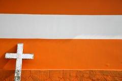 White Cross on Urban orange Brick Church Stock Photo
