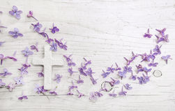 White cross and violet or purple lilac blossom on old background Royalty Free Stock Images