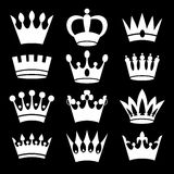 White crowns on black background. Royalty Free Stock Images