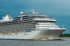 Cruise liner at summer. White cruise liner moving to the sea at cloudy day Royalty Free Stock Images