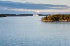White cruise liner at sunset Stock Image