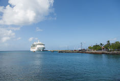 White Cruise Ship on Blue Horizon. A luxury cruise ship docked in St Croix Royalty Free Stock Photography