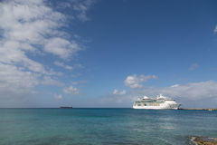 White Cruise Ship Between Blue Sky and Blue Bay. White Luxury Cruise Ship Docked at St Croix Stock Photo