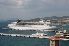White Cruise Ship and Greek Ferry docked at the Aeagen Sea Port Stock Photo