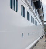 White Cruise Ship Hull with Portholes Royalty Free Stock Photos