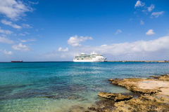 White Cruise Ship Past Rocky Shore. White Luxury Cruise Ship Docked at St Croix Stock Photos