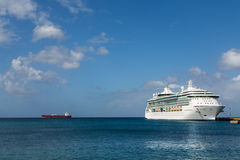 White Cruise Ship and Red Freighter. White Luxury Cruise Ship Docked at St Croix Stock Photo