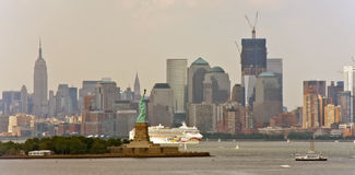 White Cruise Ship and Statue of Liberty Stock Image