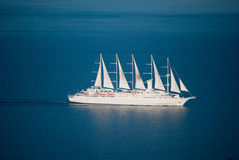 The white cruise ship on summer seas. White reflections of the blue sea Royalty Free Stock Photo