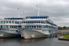 White cruise ships moored to the pier. RUSSIA, SAINT PETERSBURG - AUGUST 18, 2017: Berth Utkina Zavod. White cruise ships moored to the pier Stock Images