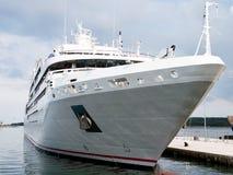White cruiser. Modern cruise ship anchored in port Royalty Free Stock Image