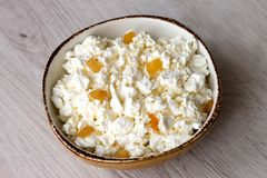White crumbly curd lies in a bowl stock photography