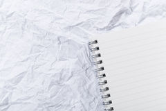 White crumple paper and notepad Royalty Free Stock Photos