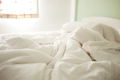 White crumpled morning sheets Stock Image