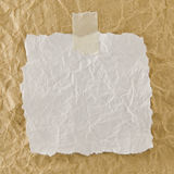 White crumpled paper. On brown background Royalty Free Stock Image
