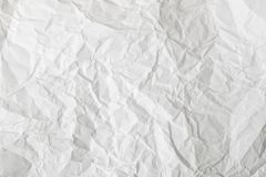 White crumpled paper background and texture. Wrinkled creased paper white abstract. White background with paper texture. Rough surface for various purposes stock photography