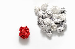 White crumpled paper ball and different red crumpled paper ball. On a white background Royalty Free Stock Photos
