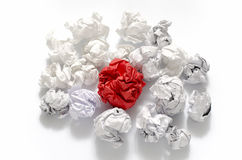 White crumpled paper ball and different red crumpled paper ball. On a white background Stock Photos