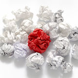 White crumpled paper ball and different red crumpled paper ball. On a white background Royalty Free Stock Photography