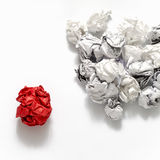 White crumpled paper ball and different red crumpled paper ball. On a white background Stock Images