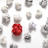 White crumpled paper ball and different red crumpled paper ball. On a white background Stock Photo