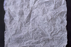 White crumpled paper. On black background Royalty Free Stock Photo
