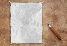 White crumpled paper on brown concrete. Background horizontal Royalty Free Stock Photos