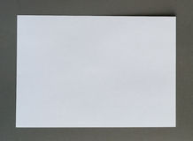 White crumpled paper on gray background Stock Image