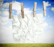 White crumpled paper hung on a laundry line Royalty Free Stock Photography
