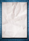 White Crumpled Paper On Blue Jeans Royalty Free Stock Image