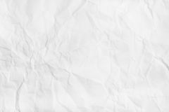 White Crumpled paper texture. Flat lay, top view. Royalty Free Stock Images