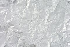 White crumpled sheet of paper. Crumpled aluminum foil background royalty free stock image