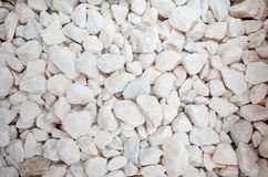 Ruschita 20mm White Crushed Marble Chips suitable for paths or ground cover where a sharp contrast is required. White Crushed Marble Chips suitable for paths or Stock Images