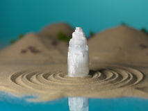 White crystal in miniature sea shore landscape Stock Images