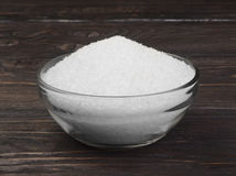 The white crystals of salt in a glass bowl Royalty Free Stock Images