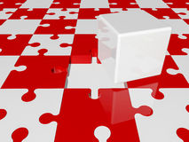 White cube on puzzle pieces in red and white colors Royalty Free Stock Photo