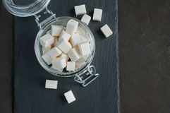 White cubes sugar in a glass jar Royalty Free Stock Photography